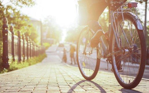 Woman riding bike at sunrise